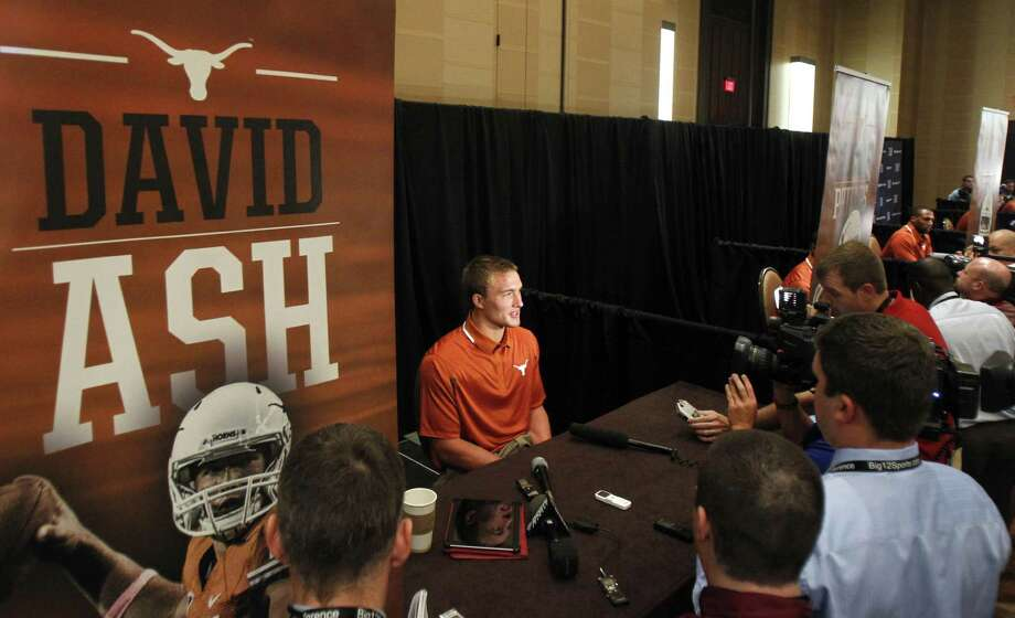 Texas junior David Ash talks to reporters in Dallas. The quarterback from Belton led the Longhorns to a 9-3 record in his 12 starts last season, including a 31-27 comeback win over Oregon State in the Valero Alamo Bowl. Photo: Tim Sharp / Associated Press
