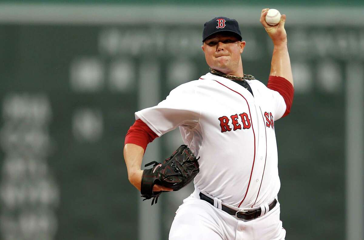 BOSTON, MA - JULY 23: Jon Lester #31 of the Boston Red Sox throws in the first inning against the Tampa Bay Rays inning at Fenway Park on July 23, 2013 in Boston, Massachusetts. (Photo by Jim Rogash/Getty Images) ORG XMIT: 163494663