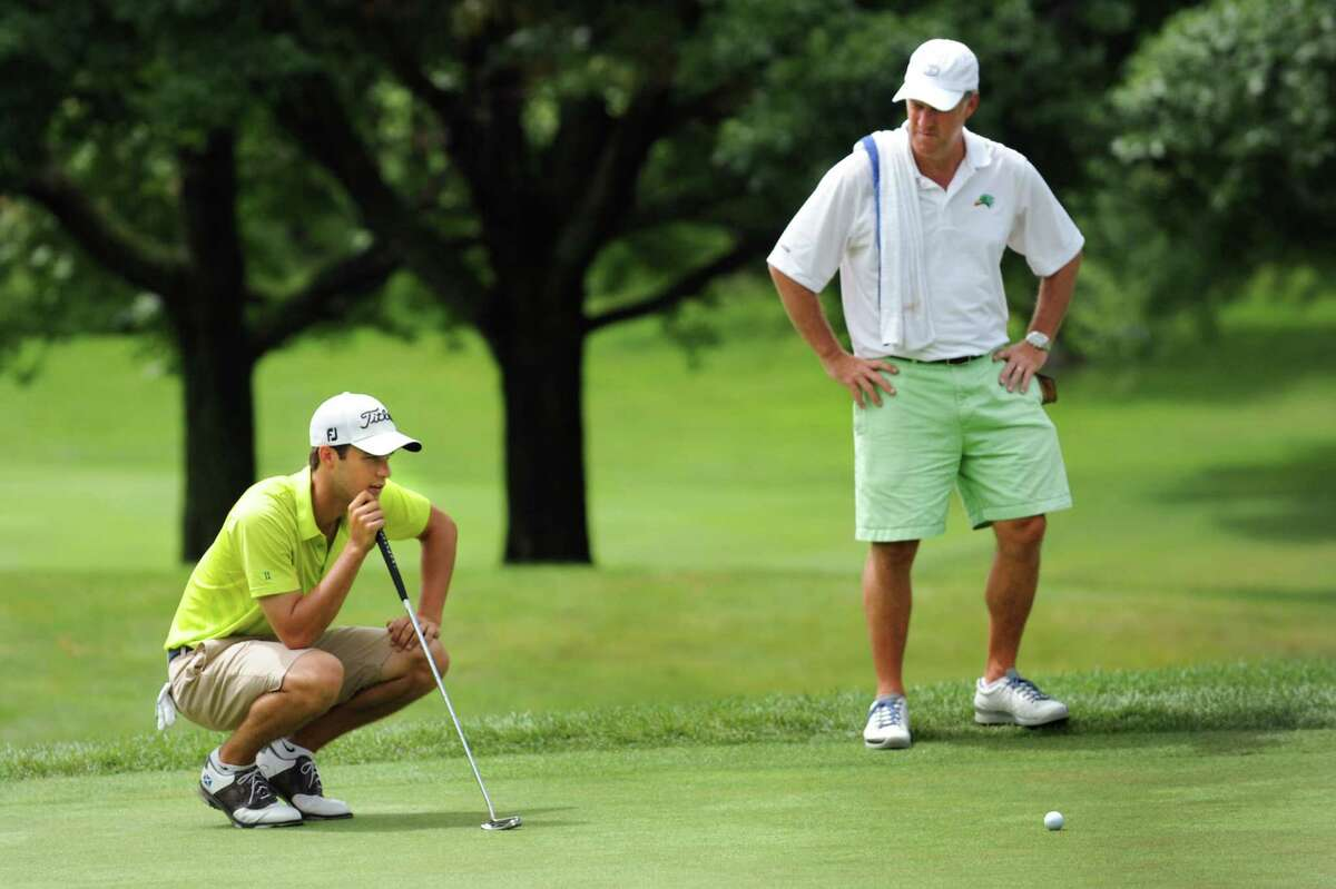 Austin Teal of Schuyler Meadows Club, left, lines up his putt during the opening round of the State Amateur golf tournament Tuesday, July 23, 2013, at Schuyler Meadows Club in Loudenville, N.Y. (Cindy Schultz / Times Union)