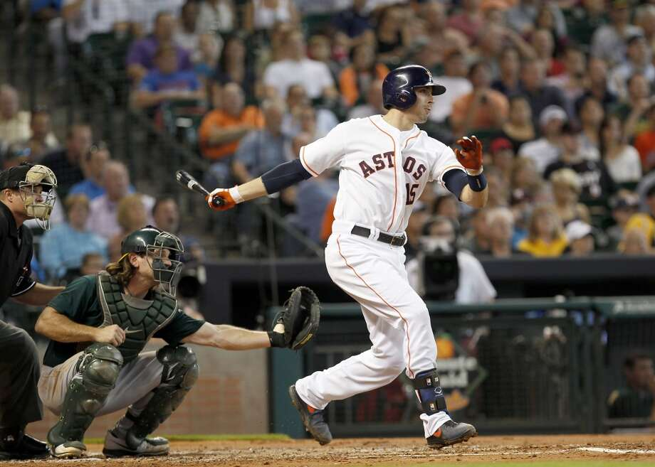 Astros catcher Jason Castro hits an RBI single during the first inning. Photo: Thomas B. Shea, For The Chronicle