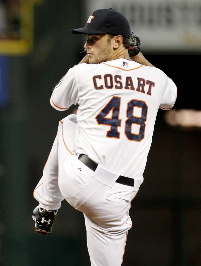 Astros pitcher Jarred Cosart delivers a throw to the A's. Photo: Thomas B. Shea, For The Chronicle