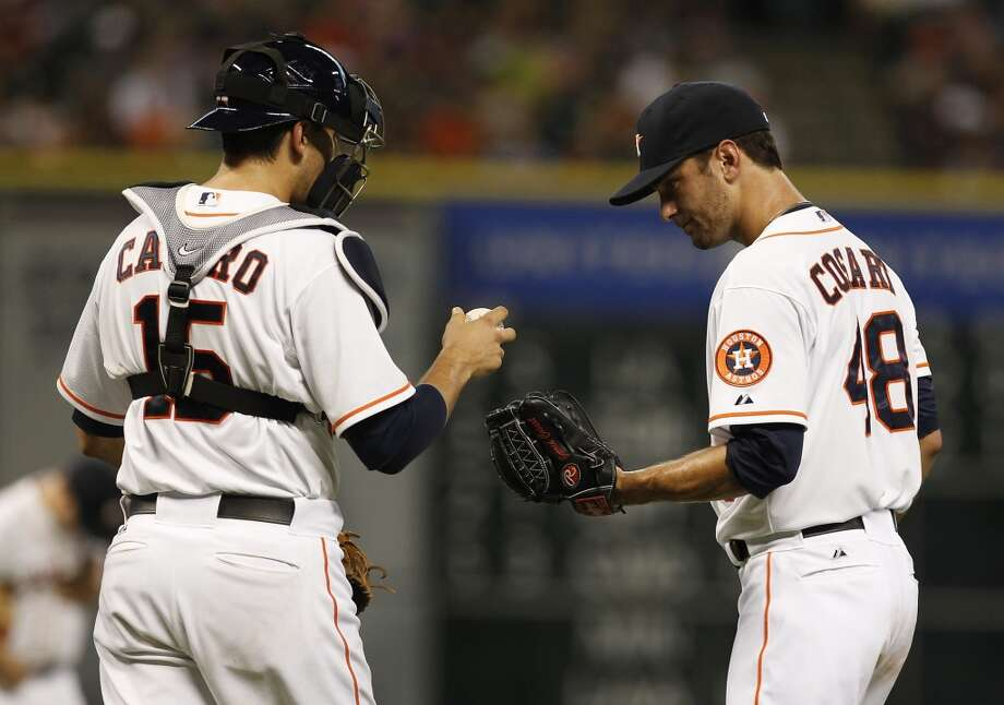 Astros pitcher Jarred Cosart speaks with catcher Jason Castro. Photo: Thomas B. Shea, For The Chronicle