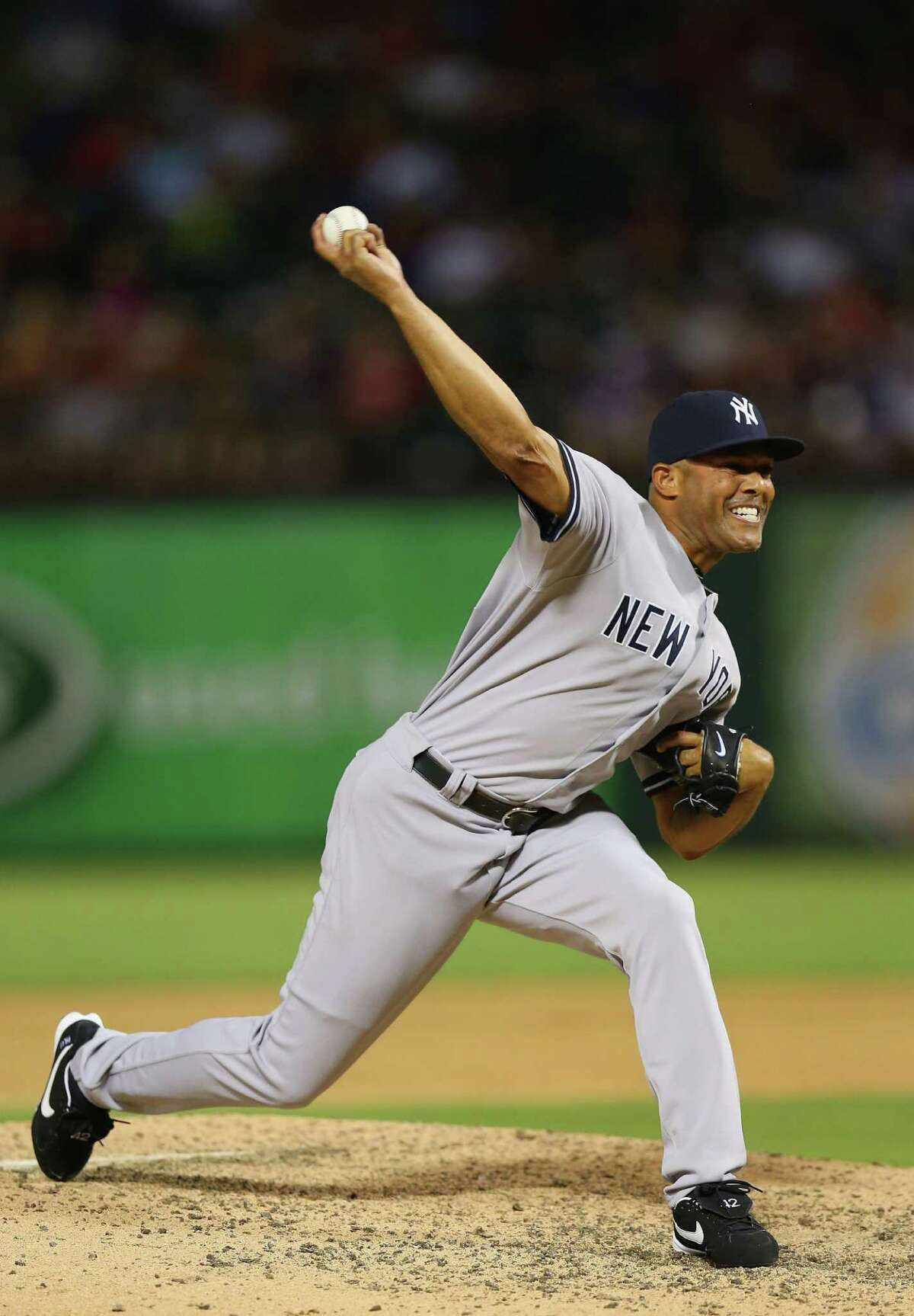 ARLINGTON, TX - JULY 23: Mariano Rivera #42 of the New York Yankees throws against the Texas Rangers at Rangers Ballpark in Arlington on July 23, 2013 in Arlington, Texas. (Photo by Ronald Martinez/Getty Images) ORG XMIT: 163494659