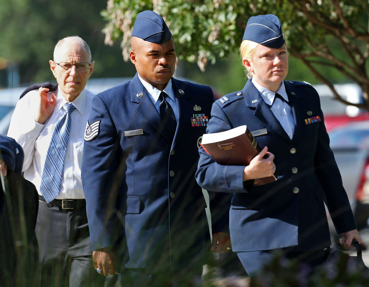 Tech. Sgt. Marc Gayden (center) arrives at Lackland AFB on Tuesday for his trial on sodomy and rape charges.