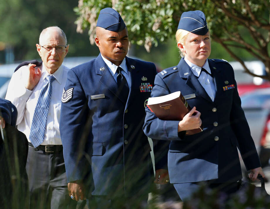 Tech. Sgt. Marc Gayden (center) arrives at Lackland AFB on Tuesday for his trial on sodomy and rape charges. Photo: Jerry Lara / San Antonio Express-News