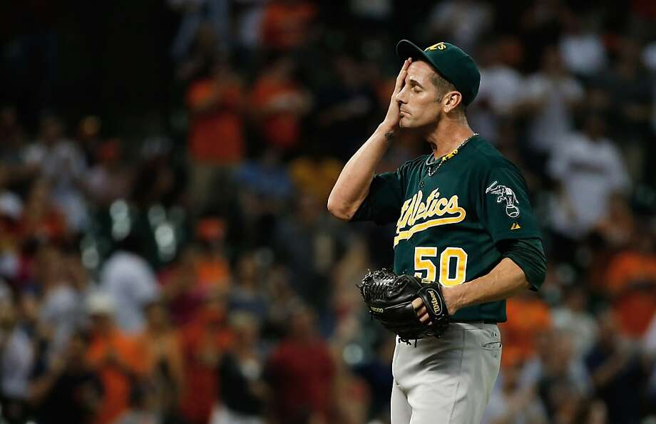 Reliever Grant Balfour reacts to a hit in the ninth inning. Balfour's team record saves streak of 44 ended Tuesday. Photo: Scott Halleran, Getty Images