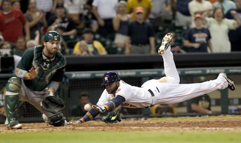 Astros shortstop Jonathan Villar slides home safely to score the winning run in the bottom of the ninth inning. Photo: Thomas B. Shea, For The Chronicle
