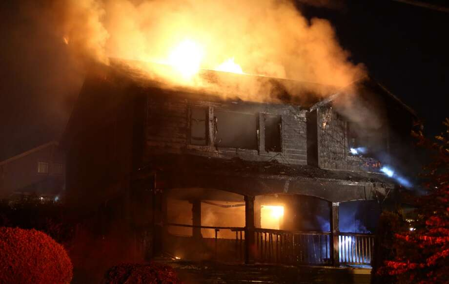 A home is engulfed in flame on 3rd Avenue NW in Seattle. Photo: JOSHUA TRUJILLO, SEATTLEPI.COM
