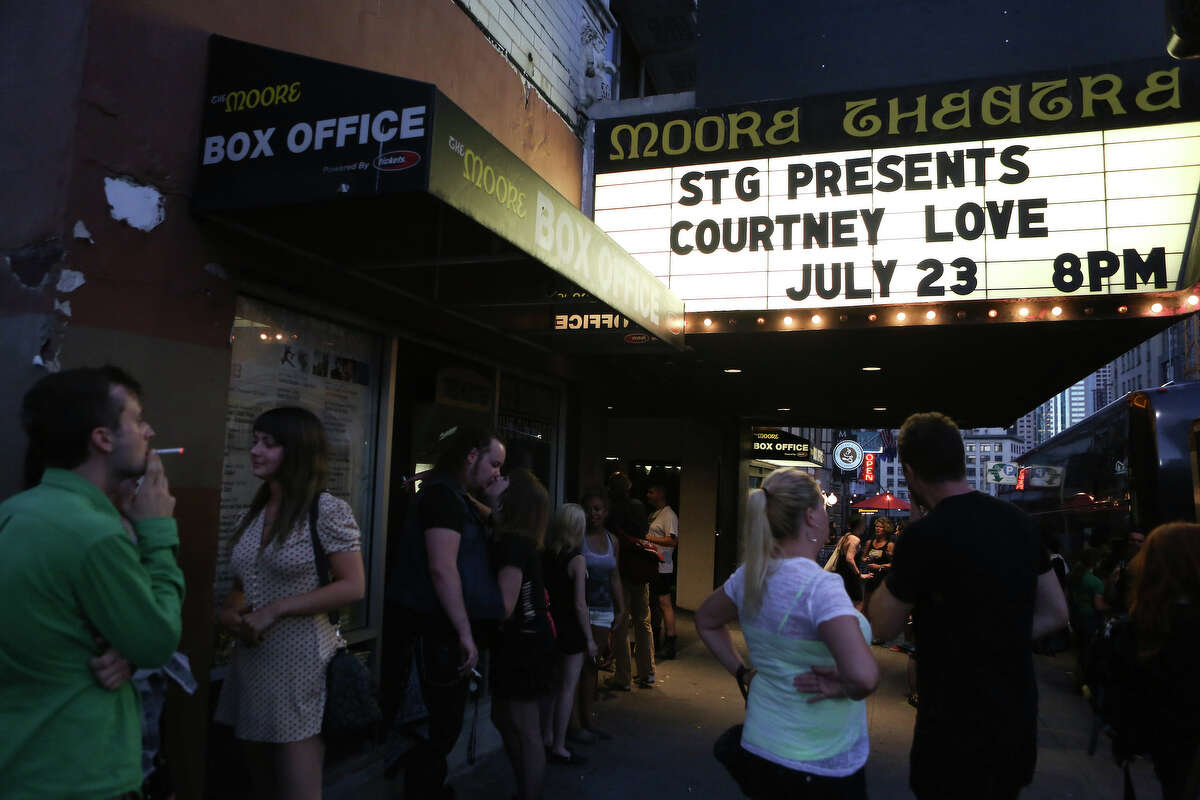 Fans gather outside before Courtney Love performs at The Moore Theatre on Tuesday, July 23, 2013.