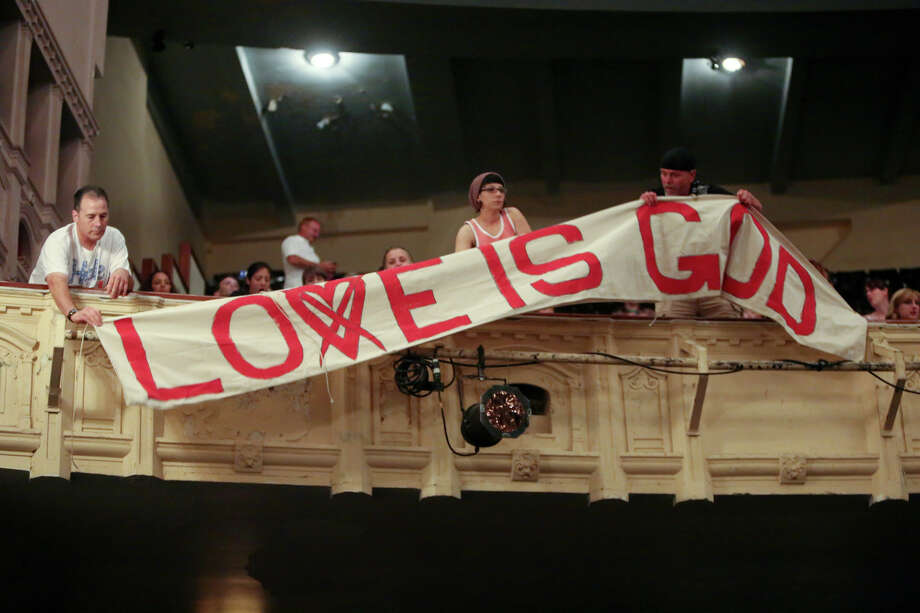 Fans hang a banner before Courtney Love performs at The Moore Theatre. Photo: JOSHUA TRUJILLO, SEATTLEPI.COM / SEATTLEPI.COM