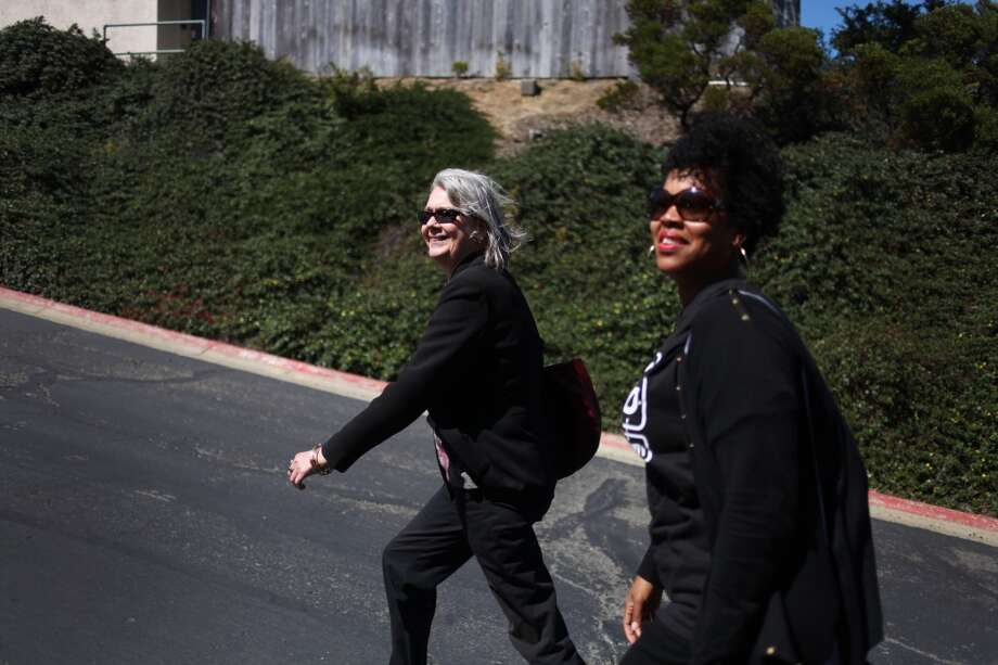 Residents Alison Dixon, left, and La Shon Walker walk up Bayview Circle while conducting a tour for the media in the Silverview Terrace neighborhood on Mt. St. Joseph on July 18, 2013 in San Francisco, Calif. Photo: The Chronicle