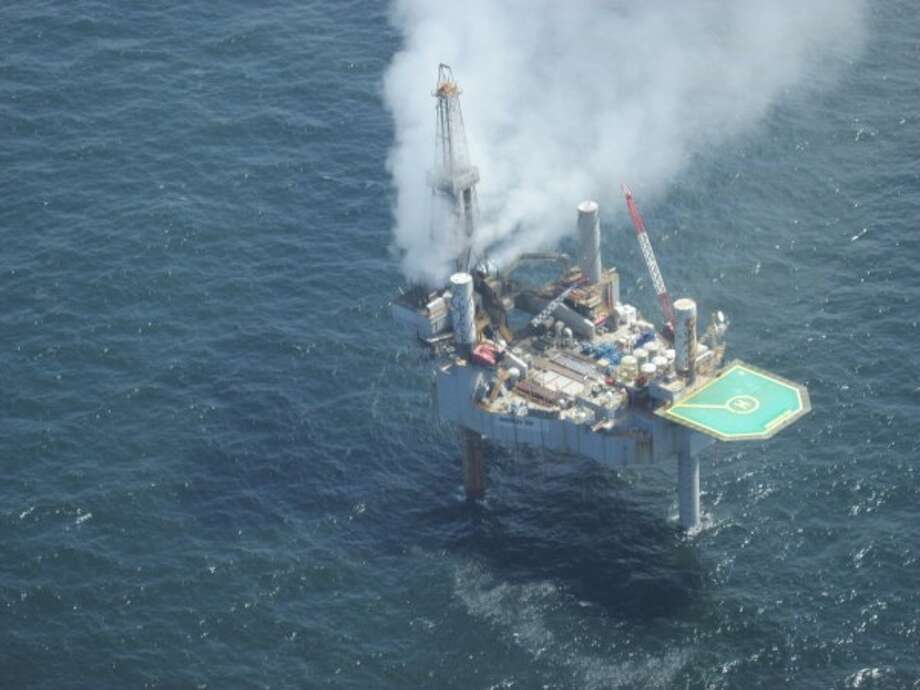 A cloud of natural gas flowing from an undersea well forms over the Hercules 265 drilling rig. Workers evacuated the rig after a loss of well control Tuesday, July 23, 2013. Photo: Bureau Of Safety And Environmental Enforcement