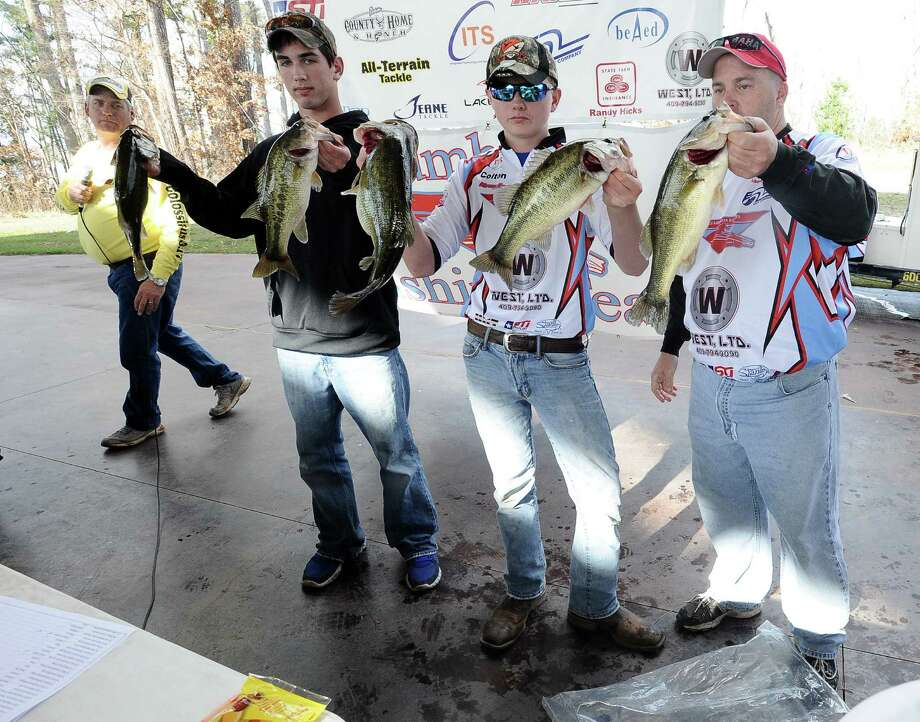 Lumberton High School freshmen angler team Zachary Johnson, left, and Colton Sims, center, stand with Lumberton fishing coach Bryan Thomas, right, showing off the biggest catch of the day at the Premier Yamaha's Lumberton High School Open on Saturday, February 2, 2013, at Lake Sam Rayburn. Photo taken: Randy Edwards/The Enterprise Photo: Randy Edwards