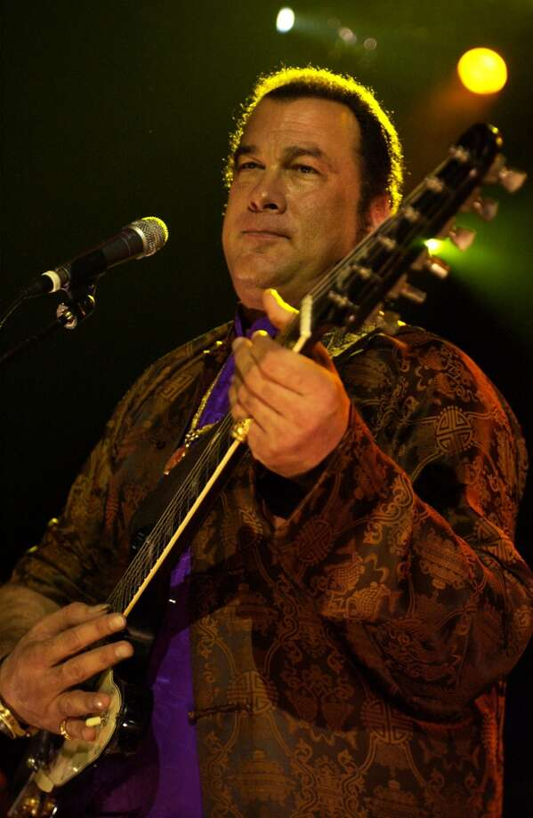 In addition to kicking people in the head, Steven Seagal also plays guitar. He has released two albums: 'Songs from the Crystal Cave' in 2005 and 'Mojo Priest' in 2006. Photo: Samir Hussein, Getty Images
