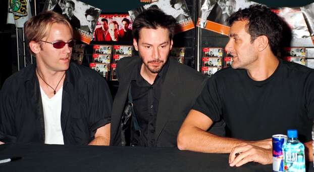 Keanu Reeves, center played bass for Dogstar. He was the most famous member of the trio that disbanded in 2002, which also included Bret Domrose (left) and drummer Rob Mailhouse. Photo: George De Sota, Getty Images