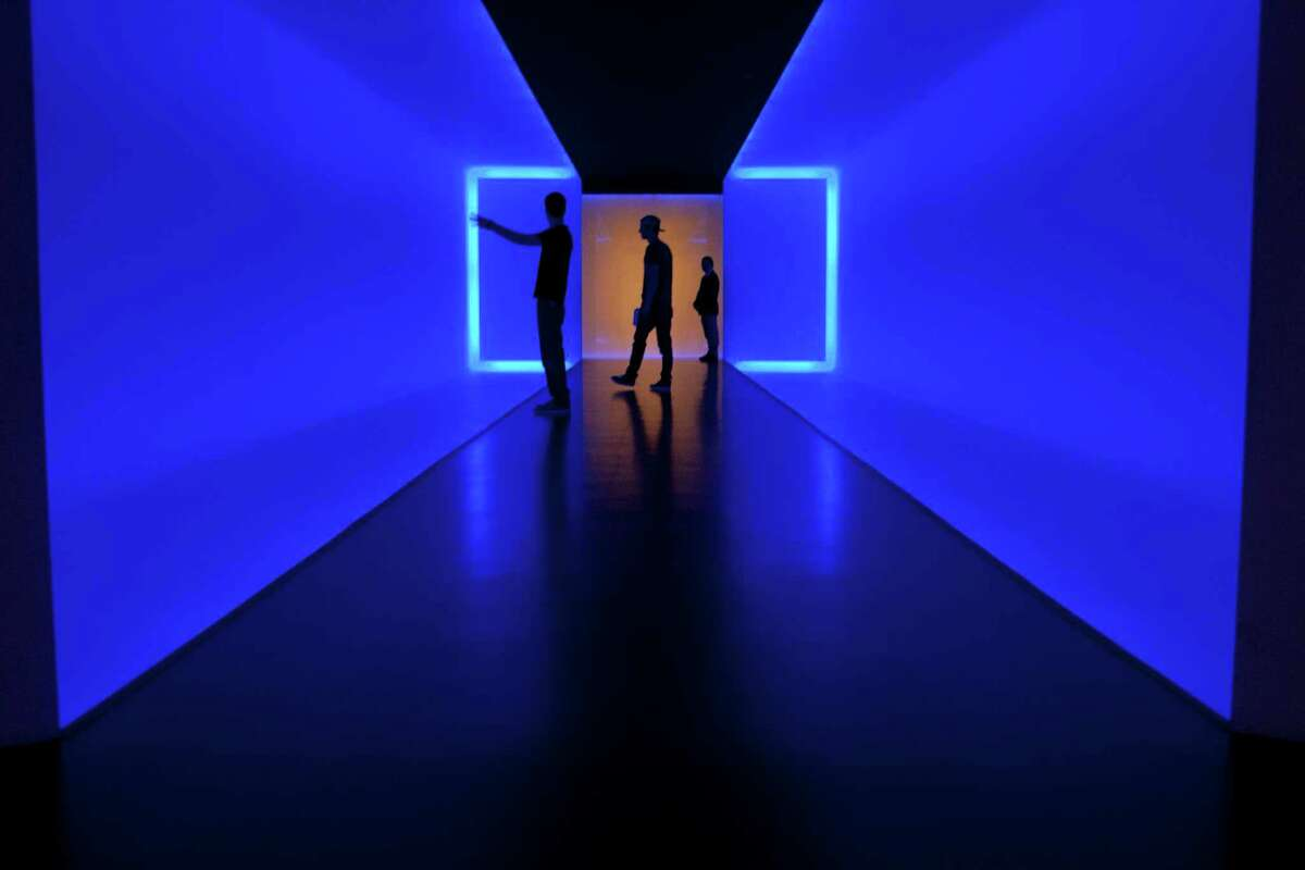 Visitors walk within 'The Light Inside' tunnel by James Turrell at the Museum of Fine Arts, Houston.