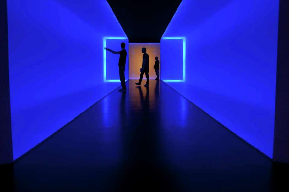Visitors walk within 'The Light Inside' tunnel by James Turrell at the Museum of Fine Arts, Houston. Photo: James Nielsen, Staff / Ã  2013 Houston Chronicle