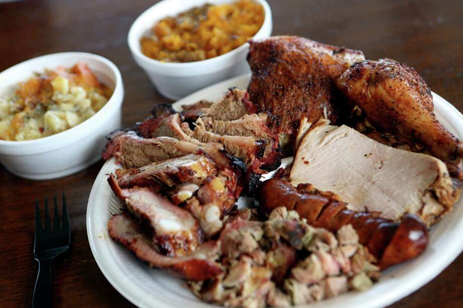 Big Bib sampler (1/4 pound of each meat and 2 sides) from Big Bib located at 104 Lanark Drive, photographed Tuesday July 23, 2013. Photo: Helen L. Montoya, SAN ANTONIO EXPRESS-NEWS / SAN ANTONIO EXPRESS-NEWS