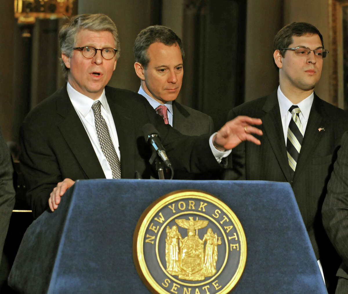 From left, Manhattan District Attorney Cyrus R. Vance, Jr. speaks during a press conference at the Capitol in Albany, NY on May 4, 2010. State Senator Eric Schneiderman and Assembly Member Micah Kellner listen in the background. For announcement of major reforms to combat public corruption.