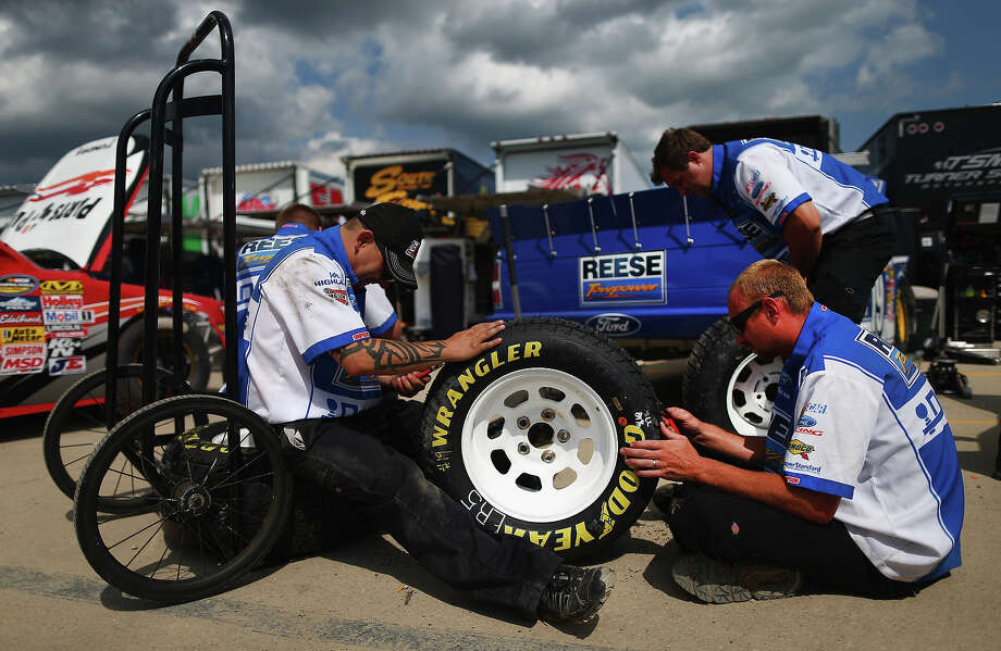 Crew members of the #19 Reese Towpower Ford, driven by Dave Blaney, prepare for practice for the NASCAR Camping World Truck Series inaugural Mudsummer Classic at Eldora Speedway on July 23, 2013 in Rossburg, Ohio. Photo: Tom Pennington, Getty Images / 2013 Getty Images