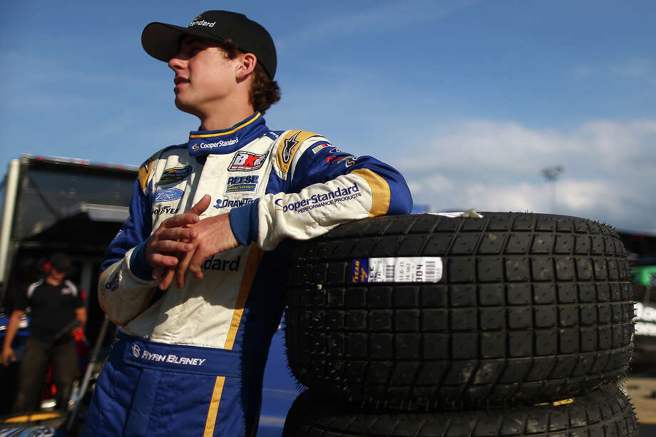 Ryan Blaney, driver of the #29 Cooper Standard Ford, stands in the garage area during practice for the NASCAR Camping World Truck Series inaugural CarCash Mudsummer Classic at Eldora Speedway on July 23, 2013 in Rossburg, Ohio. Photo: Chris Graythen, NASCAR Via Getty Images / 2013 NASCAR