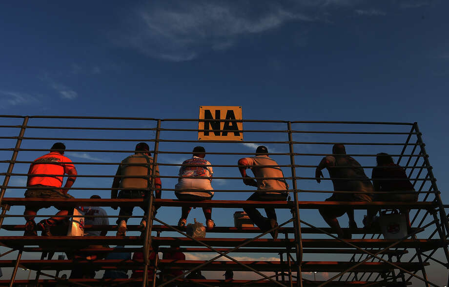 Race fans watch during practice for the NASCAR Camping World Truck Series inaugural Mudsummer Classic at Eldora Speedway on July 23, 2013 in Rossburg, Ohio. Photo: Tom Pennington, Getty Images / 2013 Getty Images