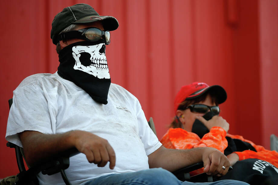 Fans watch during practice for the NASCAR Camping World Truck Series inaugural CarCash Mudsummer Classic at Eldora Speedway on July 23, 2013 in Rossburg, Ohio. Photo: Chris Graythen, NASCAR Via Getty Images / 2013 NASCAR