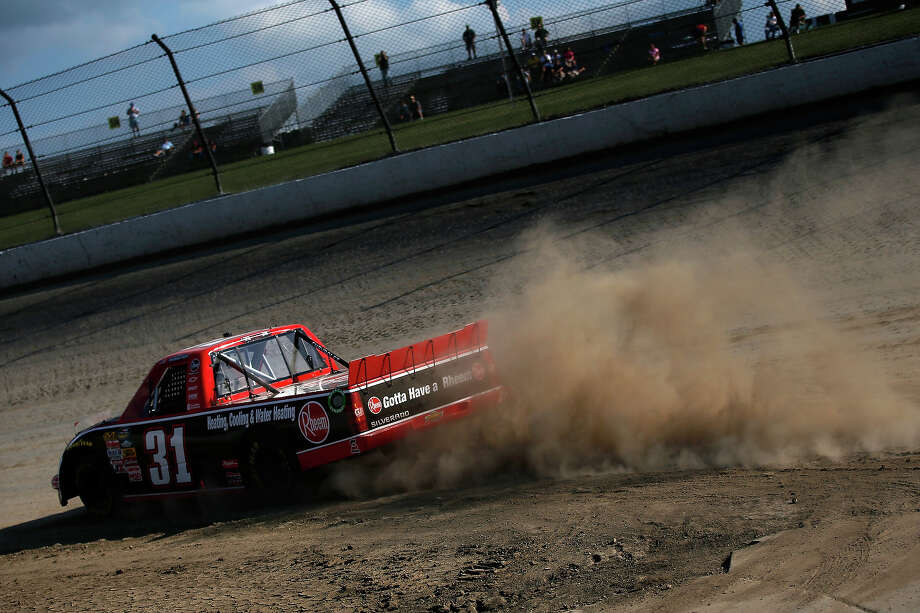 James Buescher, driver of the #31 Rheem Chevrolet drives during practice for the NASCAR Camping World Truck Series inaugural CarCash Mudsummer Classic at Eldora Speedway on July 23, 2013 in Rossburg, Ohio. Photo: Chris Graythen, NASCAR Via Getty Images / 2013 NASCAR