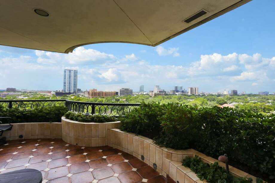 A private balcony overlooks downtown Houston.