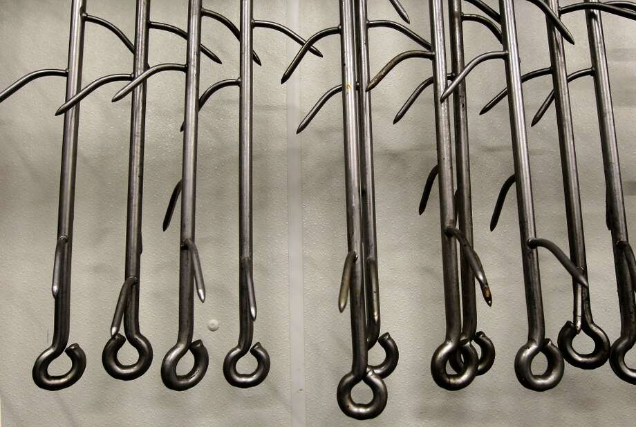 Meat hooks hang from a rack at the United Meat company building. Photo: Michael Macor, San Francisco Chronicle