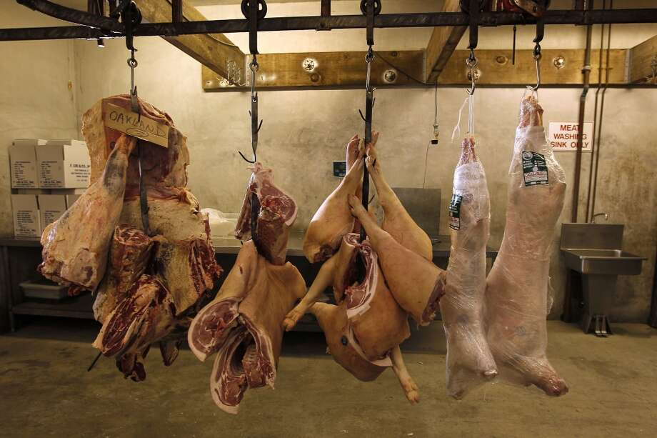 Beef and pork hang from hooks at Marin Sun Farms at their present location in the Dogpatch. Photo: Michael Macor, San Francisco Chronicle