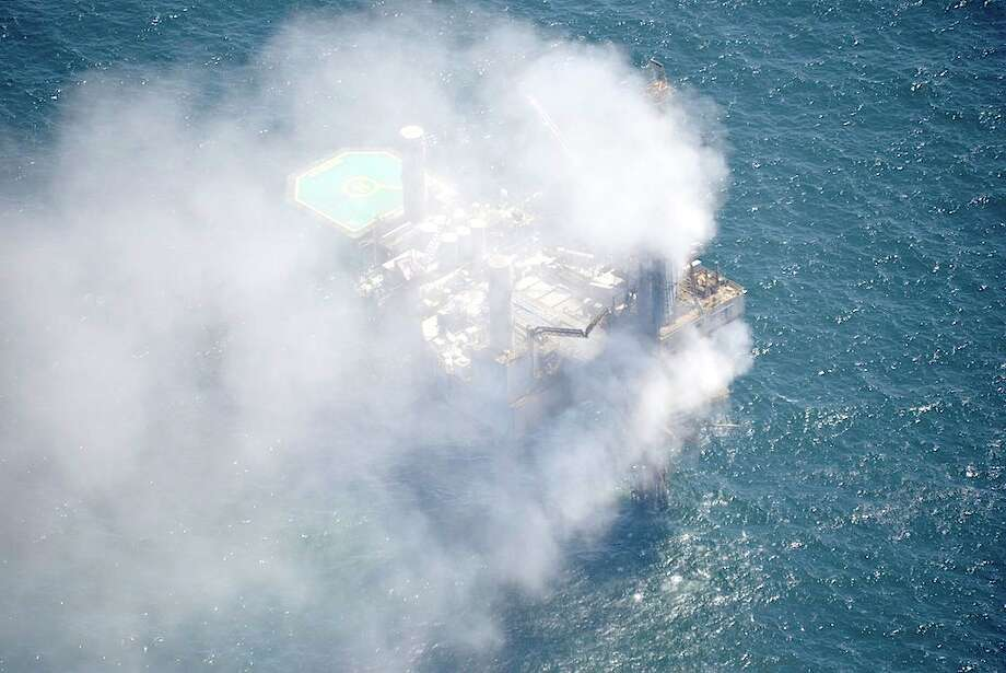 A cloud of natural gas billows over the Hercules 265 drilling rig from an undersea well. Workers evacuated the rig after a loss of well control Tuesday, July 23, 2013. Photo: On Wings Of Care, Copyright 2013
