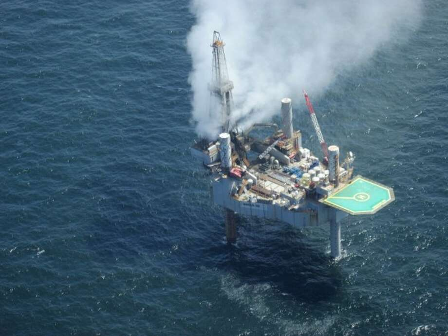 A cloud of natural gas billows over the Hercules 265 drilling rig from an undersea well. Workers evacuated the rig after a loss of well control Tuesday, July 23, 2013. Photo: On Wings Of Care