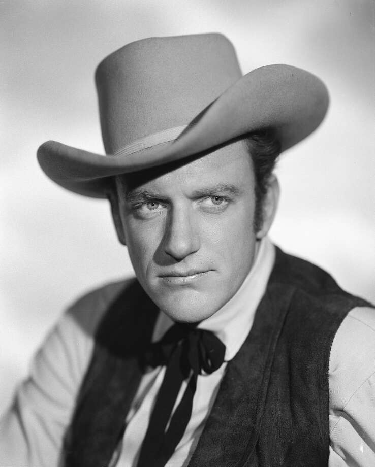 "James ArnessAs Marshal Matt Dillon in ""Gunsmoke"" for 20 years — with more episodes than ""Law & Order,"" the longest running prime time drama in American history — Arness laid down the law, but never Miss Kitty. Photo: CBS Photo Archive, CBS Via Getty Images / 1955 CBS Photo Archive"