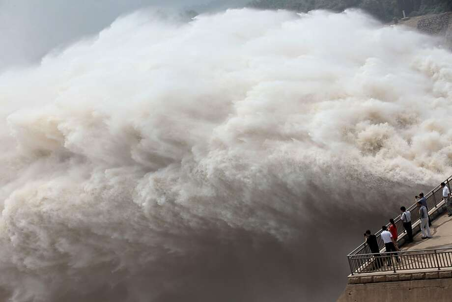 A torrent of water explodes out of dam gates as the Xiaolangdi reservoir releases Yellow 