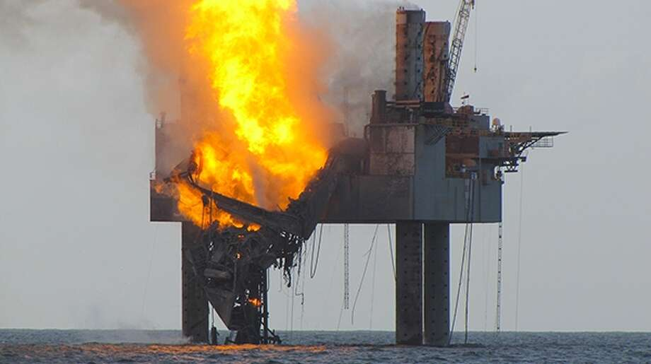 A fire ignited on the Hercules 265 jack-up rig after operators lost control of an undersea natural gas well, causing a partial collapse of the rig. Photo: U.S. Coast Guard