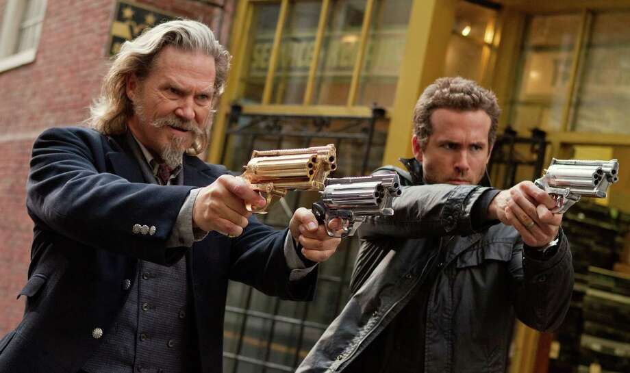 "This film publicity image released by Universal Pictures shows Jeff Bridges, left, and Ryan Reynolds in a scene from ""R.I.P.D."" The film will be released nationwide on Friday, July 19. (AP Photo/Universal Pictures, Scott Garfield) ORG XMIT: NYET363 Photo: Scott Garfield / Universal Pictures"
