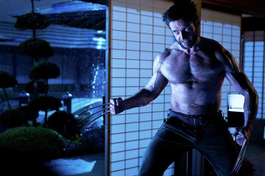 """This publicity photo released by Twentieth Century Fox shows Hugh Jackman as Logan/Wolverine in a scene from the film, """"The Wolverine.""""  (AP Photo/Twentieth Century Fox, Ben Rothstein) ORG XMIT: NYET140 Photo: Ben Rothstein / Twentieth Century Fox"""