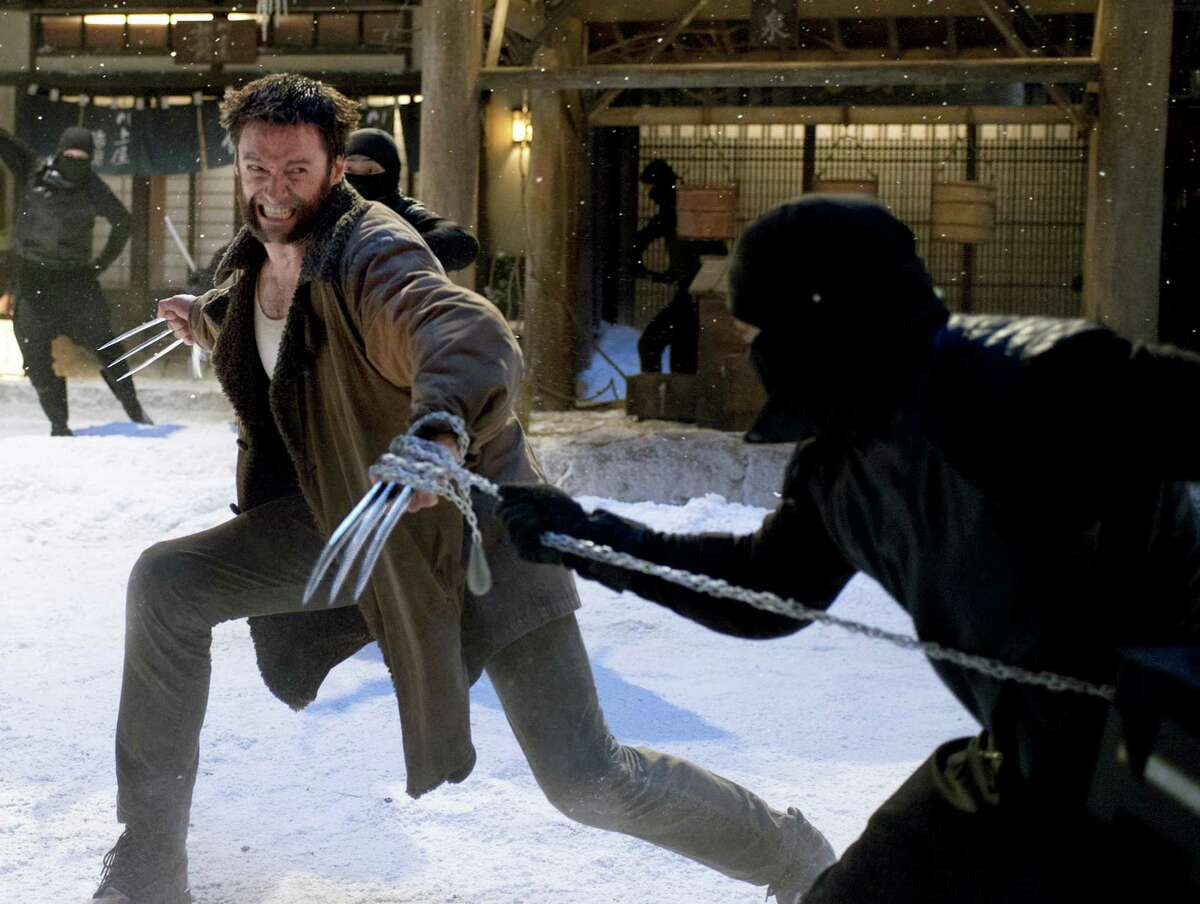 This publicity image released by 20th Century Fox shows Hugh Jackman in a scene from