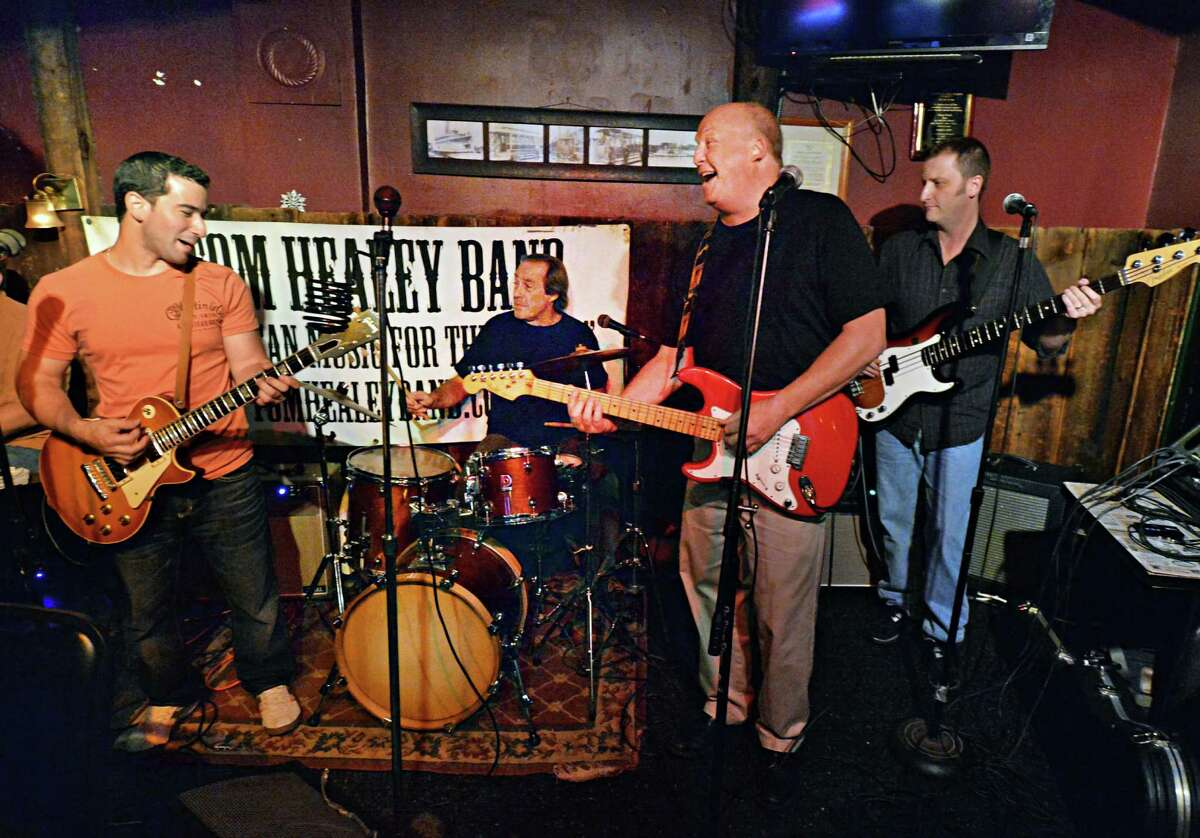 The Tom Healey Band, from left, guitarist Matt Mirabile, drummer Rob Cenci, vocalist, guitar and harmonica player Tom Healey and bass player John Ellis, perform at The Ale House in Troy Saturday July 13, 2013. (John Carl D'Annibale / Times Union)