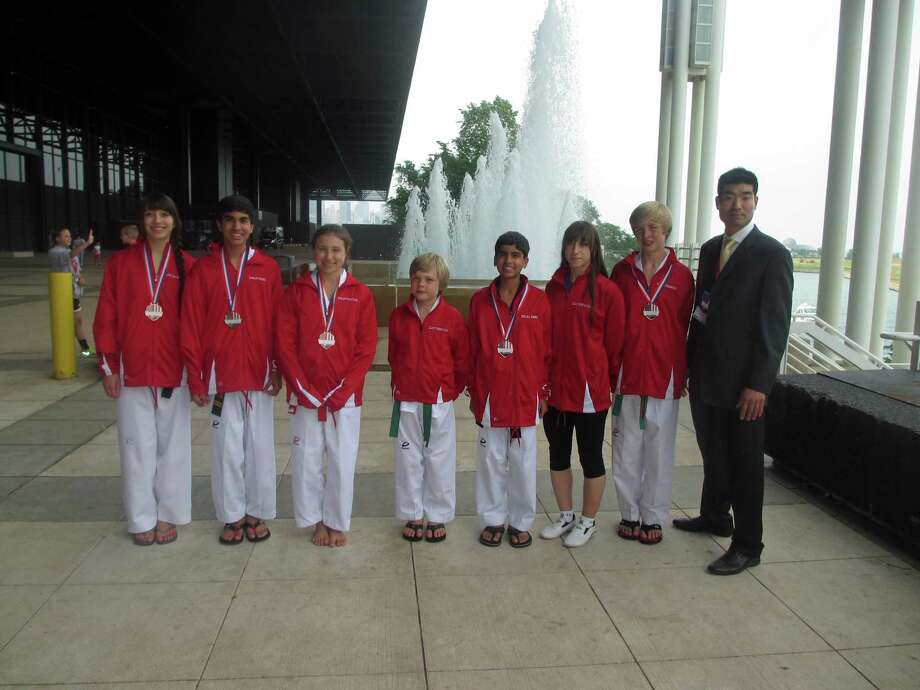 World Champion Taekwondo won eight medals at the USAT National Championships in Chicago from July 3-8. Pictured, from left to right, are Julia Weiss, Arum Soni, Samantha Atlas, Elliot Frennstedt, Neal Soni, Viktor Frennstedt, Emily Rose Weiss and coach Master Donghyun Jang. Photo: Contributed Photo
