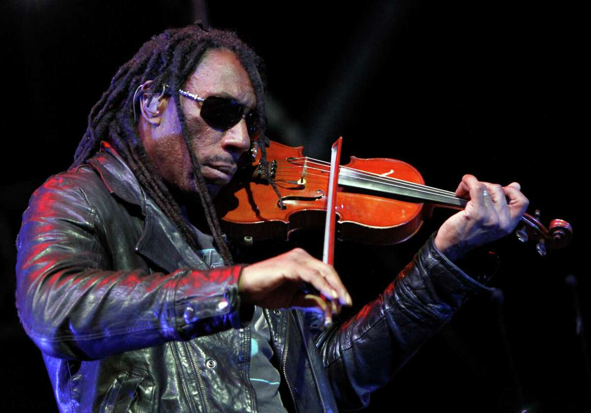 FILE - This April 5, 2013 file photo shows Boyd Tinsley of the Dave Matthews Band performing at the NCAA Final Four Big Dance Concert in Centennial Olympic Park in Atlanta, Ga. Court documents say Getty Andrew Rothenberg pleaded guilty Tuesday, July 23, embezzling at least $400,000 from Tinsley. The documents say the 39-year-old Richmond man embezzled the money while working as Tinsley's personal assistant and financial manager. (Photo by Dan Harr/Invision/AP, File) ORG XMIT: NYET216
