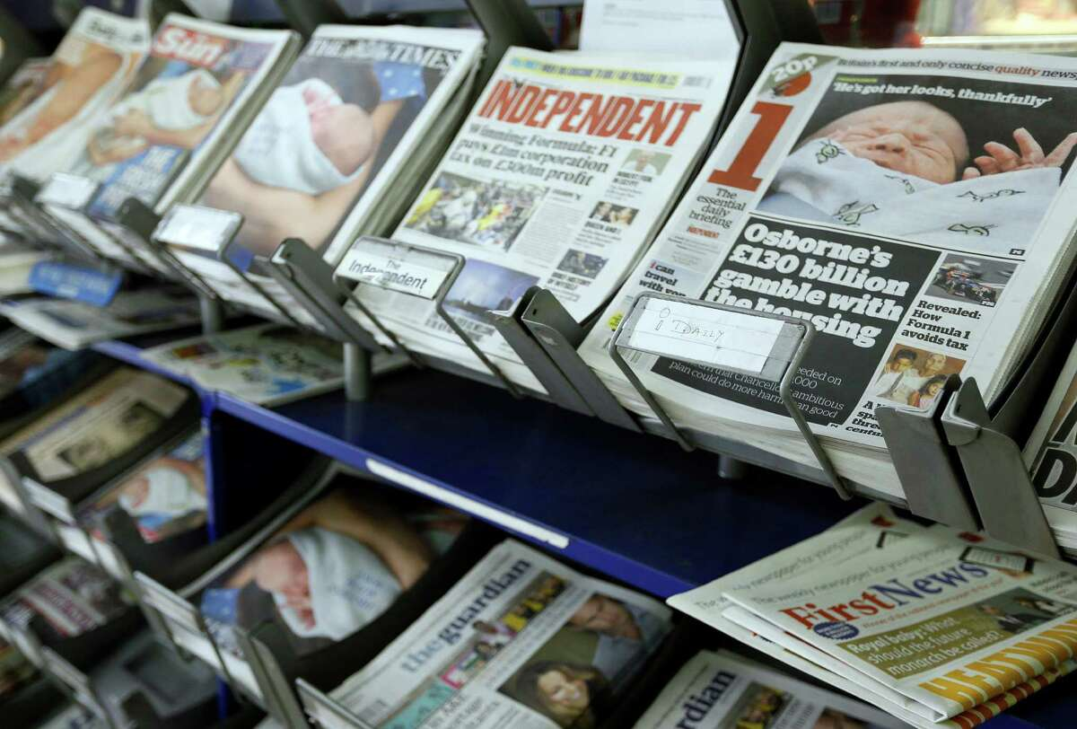 British newspapers are displayed for sale in London, Wednesday, July 24, 2013. The newspapers show coverage of the new royal baby boy, third in line to the throne. (AP Photo/Kirsty Wigglesworth) ORG XMIT: LKW104
