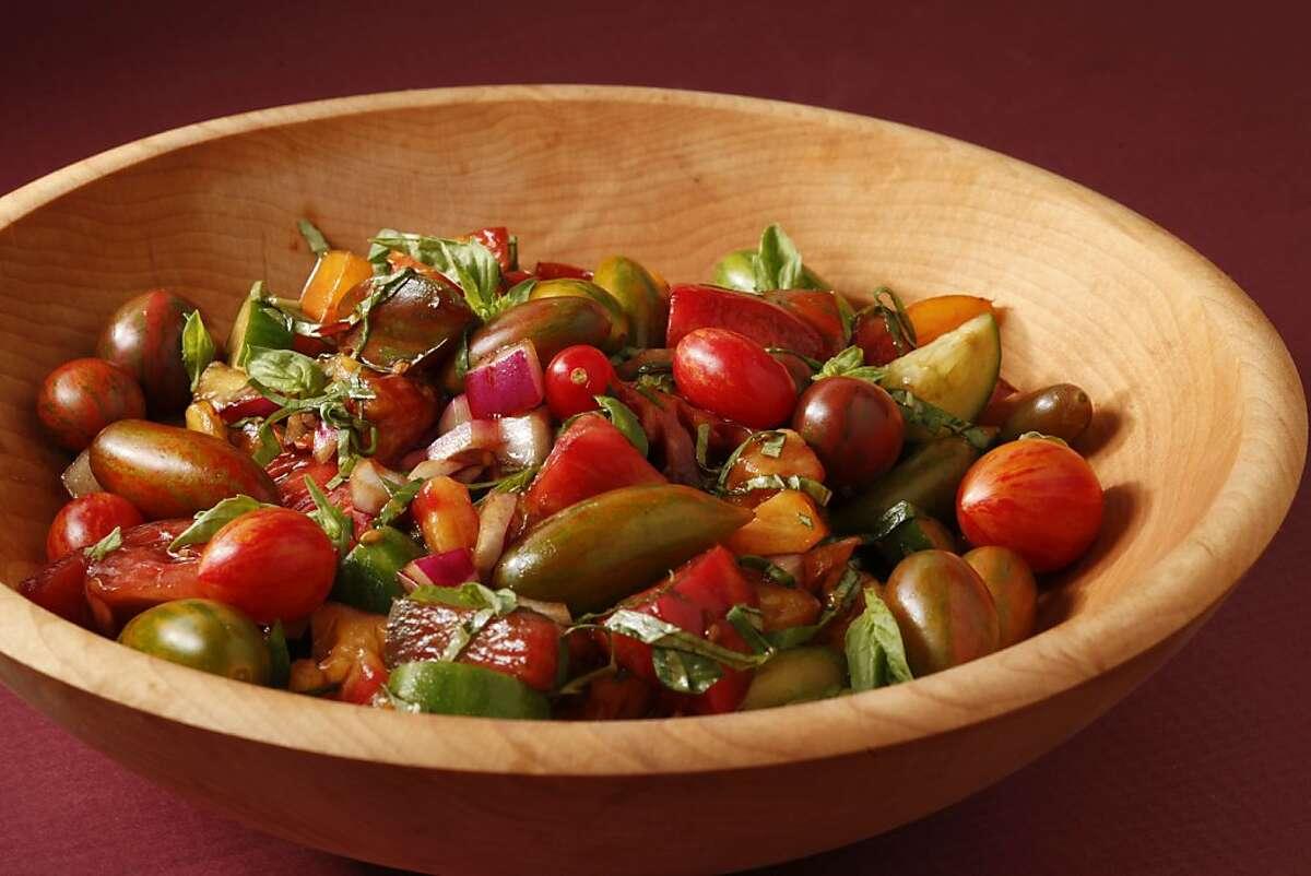 Sweet Summer Heirloom Tomato Salad as seen in San Francisco, California, on July 17, 2013. Food styled by Lynne Bennett.