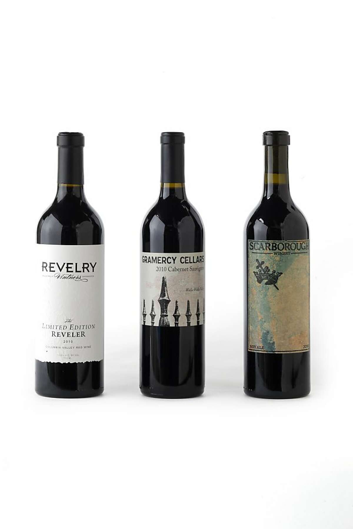 Left-right: 2010 Revelry Vintners The Limited Edition Reveler, 2010 Gramercy Cellars Cabernet Sauvignon, 2010 Scarborough Royale as seen in San Francisco, California, on July 17, 2013.