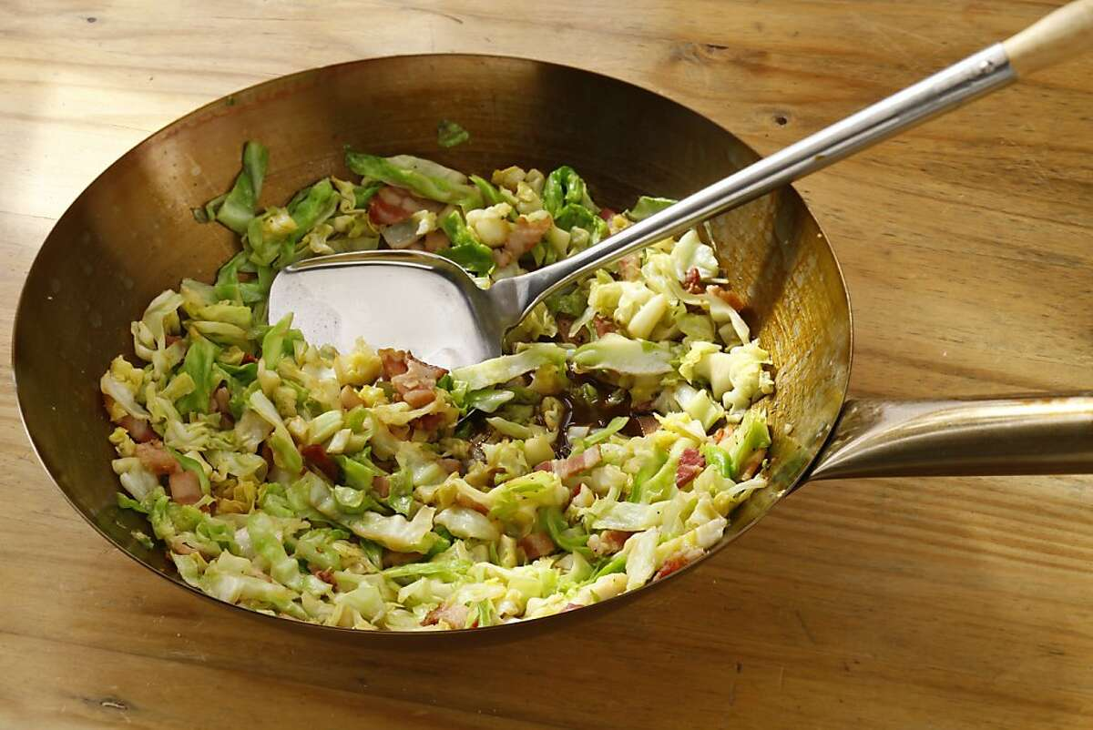 Wok with cabbage and bacon as seen in San Francisco, California, on May 29, 2013. Food styled by Tara Duggan.