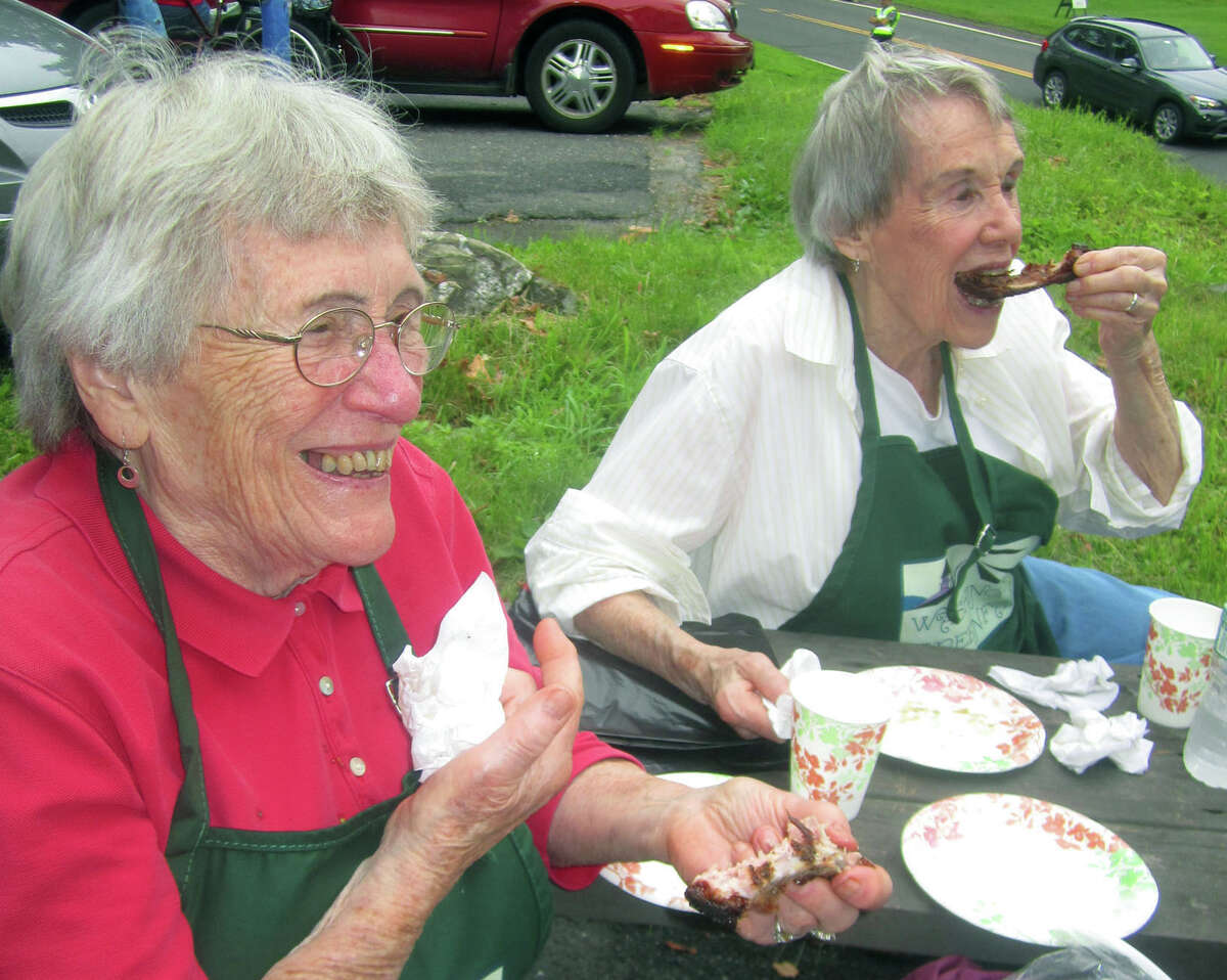 Forever young church volunteer Norma Anson, 89, and her sister, Mary Rivers, 87,take a quick break to grab lunch during the Washington Congregational Church's annual Green Fair, July 13, 2013. The sisters were baptized in the church more than a few fortnights ago.