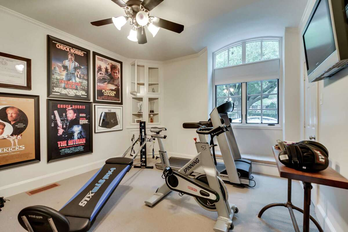 This July 15, 2013 photo courtesy of Rogers Healy and Associates Real Estate shows the gym in Texas Ranger Cordell Walker's house from the former television series