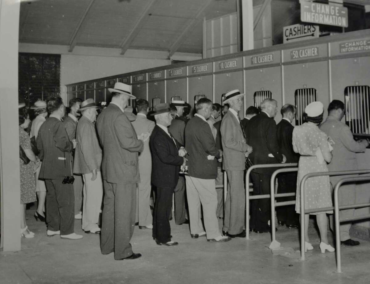 Betting windows: Betters lineup at the betting windows at Saratoga Race Course in Saratoga Springs, N.Y., date unknown. (Courtesy of Saratoga Springs Historical Museum, George S. Bolster collection)