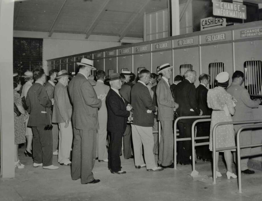 Betting windows: Betters lineup at the betting windows at Saratoga Race Course in Saratoga Springs, N.Y., date unknown. (Courtesy of Saratoga Springs Historical Museum, George S. Bolster collection) Photo: Skip Dickstein    518-369-2345